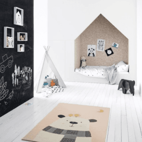 brightly lit children's room with playful panda bear rug