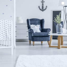 cool coloured beach house interior setting with comfortable white rug